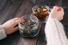 Female brew herbal tea Stock Photos
