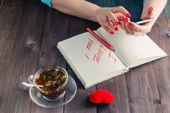 Famale write love sms - stock photo