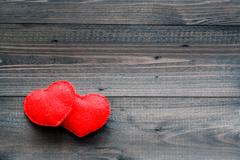 Aged wooden background with red heart - stock photo