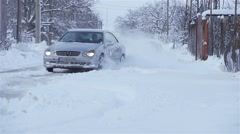 Sports car drifting snow in slow motion Stock Footage