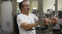 Mature Man Working Out In Fitness Center Arkistovideo