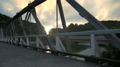 Running woman along bridge at sunset Stock Footage