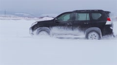Large car drifting snow in slow motion Stock Footage