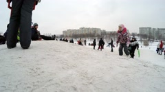 Belarus, Minsk. Children ride on a hill in the city. Arkistovideo