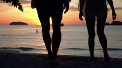 Silhouette of people walking during sunset on the beach, 120fps Stock Footage