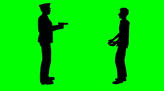 Policeman holds man at gunpoint on green screen Stock Footage