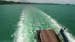 Ferry boat sails from the mainland to the Koh-Chang island, Thailand Stock Footage