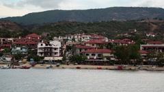 Ship sails along peninsula of Athos, autonomous monastic state, Greece Stock Footage