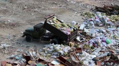 Car unloads garbage in a landfill Stock Footage