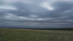 Sky-filling gray storm clouds advancing over the prairie and the camera, time - stock footage