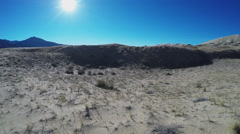 Mojave Desert Pan From Sun Over Mountains To Sand Dunes Stock Footage