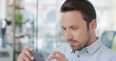 Businessman using smart phone app connecting digital device in modern office Stock Footage