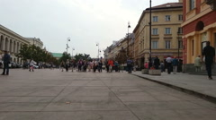 Group of Asian tourists sightseeing in historic district of Warsaw, Poland Stock Footage