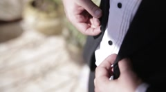 Bride adjusts buttons on jacket Stock Footage