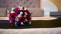 bridal bouquet lying on the bed - stock footage