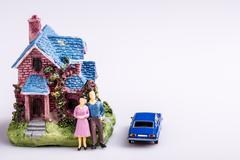 happy man and wife with blue car and new house, real estate, mortgage - stock photo