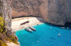 View of crowded Navagio Beach on Zakynthos - stock photo