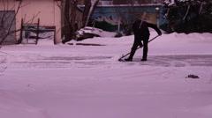 man removes snow shovel iron  - stock footage