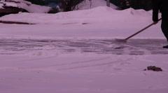 Man removes snow shovel iron  Stock Footage