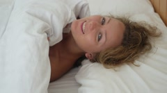 Beautiful Girl Lying in Bed Flirting and Seducing Stock Footage