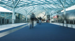 Futuristic building and walkway with fast people Stock Footage