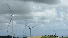 Time lapse of wind turbines rotating, thick stormy clouds flying, clean ecology - stock footage