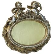 Oval baroque gold fhoto frame with cupid on isolated background - stock photo