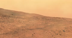 Zoom shot of moderate dust storm at Tuskegee Crater, Mars.  Stock Footage