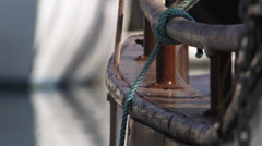 Close-up gunnel and rigging of a fishing boat at a dock - stock footage