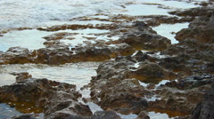 Tide waves on rocky shore, calm stony coastline, tranquil landscape, meditation Stock Footage