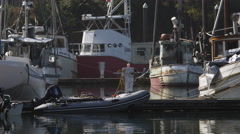 Fishing boats and a motorized raft at a dock Stock Footage