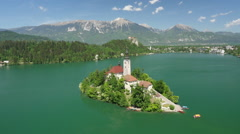 AERIAL: Stunning Bled lake island on sunny summer day - stock footage