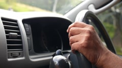 Man Driving a Car, Hands on Steering Wheel Close-up Stock Footage
