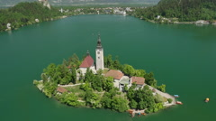 AERIAL: Flying high above beautiful lake Bled with church island - stock footage