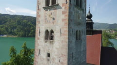 AERIAL CLOSEUP: Famous church on Bled island in beautiful lake - stock footage
