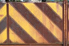 Japanese rusty yellow and black stripe patterned metal wall Stock Photos