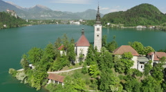 AERIAL: Famous church on the island in lake Bled Stock Footage