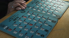 Close-up of Bingo cards and elderly woman's hands Stock Footage