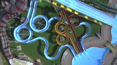 AERIAL: Young people sliding down the water slides toboggan - stock footage