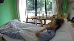 Sick Woman Using Smart Phone in Hospital Bed 2.7K Arkistovideo