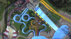 AERIAL: Big extreme waterpark with water slides and pools - stock footage