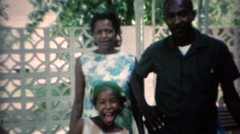 1969: African family reunion outdoor summer patio. Stock Footage