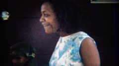 1969: Drunk African women twist dancing in blue floral dress. Stock Footage