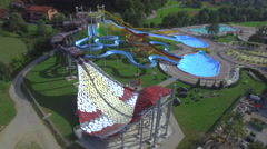 AERIAL: Flying around big extreme water park with waterslides Stock Footage
