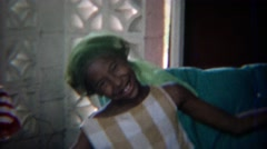 1969: Silly African girl performing in homemade halter top. Stock Footage