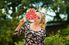 Beautiful model wearing summer dress in garden environment, holding large Stock Photos