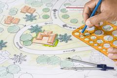 Landscape Architect Designs Blueprints For Resort. - stock photo