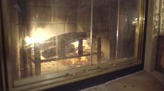 Steadicam Shot Of Fire In Fireplace, Then Closeup Of Teens Asleep Stock Footage