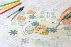 Landscape Architect Designs Blueprints For Resort. - stock photo