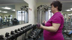 Mature Woman Working Out In Fitness Center Arkistovideo